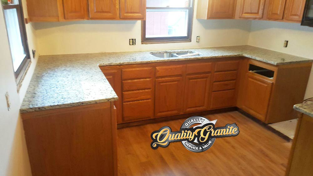 granite countertops on tan cabinets
